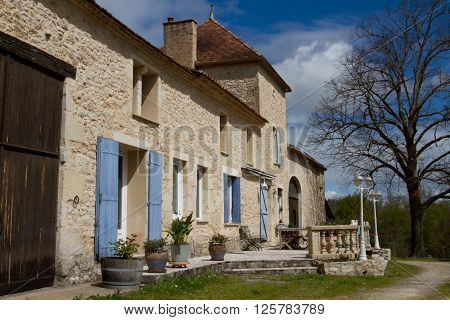 Stone house and garden on a typical french residential estate