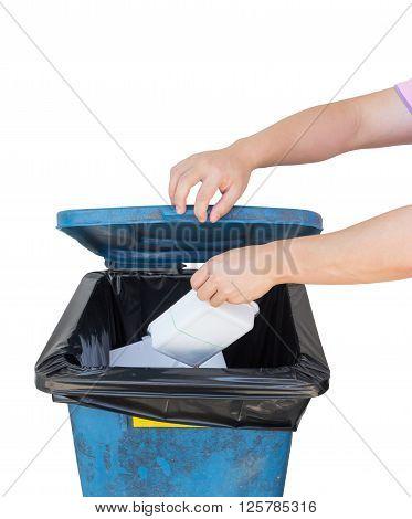 Hand dumping a foam of garbage into the bin