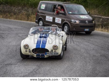 PESARO, ITALY - MAY 15: Shelby cobra  on an old racing car in rally Mille Miglia 2015 the famous italian historical race (1927-1957) on May 2015