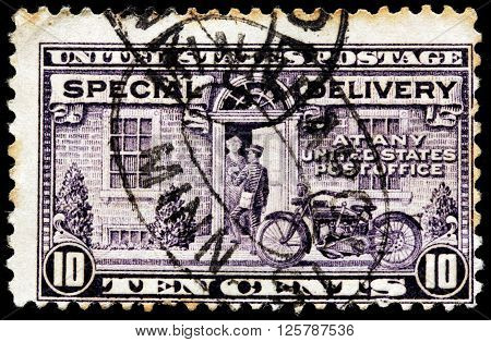 UNITED STATES - CIRCA 1931: A stamp printed by USA shows American Postman and his Motorcycle. Special Delivery issue circa 1931
