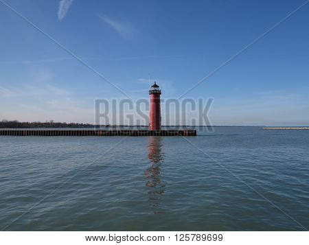 Kenosha, Wisconsin Lighthouse on bright spring day with reflection on Lake Michigan