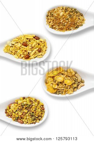Dry roasted Indian snack mix in a big spoon, isolated
