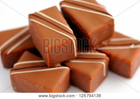 Chocolate candy praline on a white background