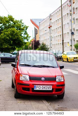 POZNAN POLAND - JUNE 19 2014: Parked red Fiat Panda by a sidewalk on the Piastowskie area