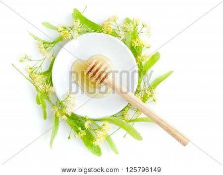 Honey Dipper With Honey With Flowers Of Linden On White Saucer, View From Above