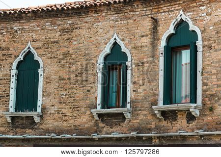 Windows And Brick Wall Facade In Murano Isle Near Venice, Italy