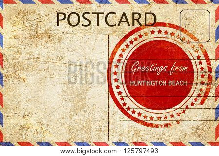 greetings from huntington beach, stamped on a postcard
