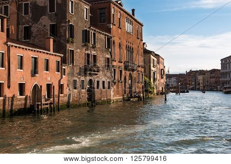 Old Facade Along Typical Water Canal In Venice, Italy