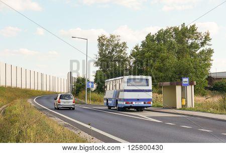 GADKI POLAND - AUGUST 26 2013: Public transport bus waiting by a bus stop