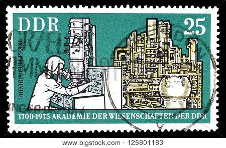 GERMAN DEMOCRATIC REPUBLIC- CIRCA 1975 : Cancelled postage stamp printed by German Democratic Republic, that shows Electron microscope and chemical plant.