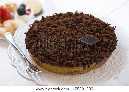 pastry cake covered with chocolate flakes and cocoa