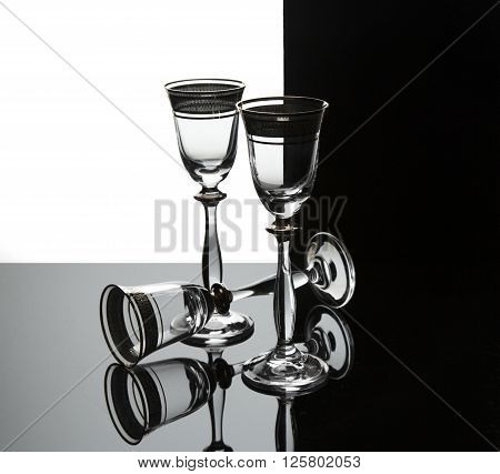 Three wineglasses on a black and withe background