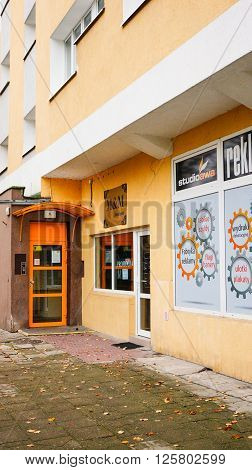 POZNAN POLAND - OCTOBER 18 2014: Entrance to a apartment block next to advertisement office on the Piastowskie area