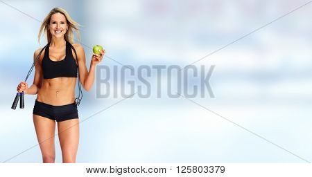 Young fitness woman with apple.