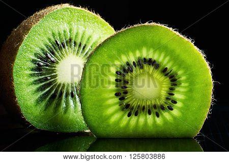 cut of kiwi fruit close-up on black background horizontal