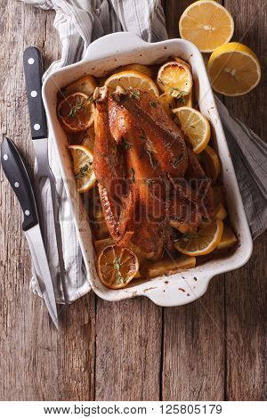 Lemon Chicken With Thyme And Potato In A Baking Dish. Vertical Top View