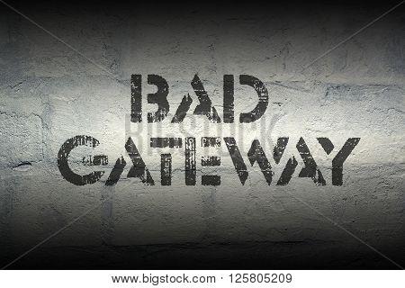 bad gateway stencil print on the grunge white brick wall