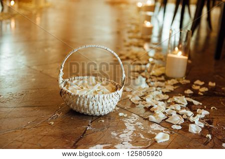 basket with rose petals in a path of rose petals.