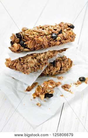 Cereal granola bars on white wooden table