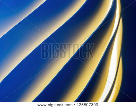 Colored spiral pattern with white, orange and blue lighting.