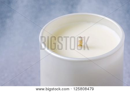 White candle in close up view.Close up view