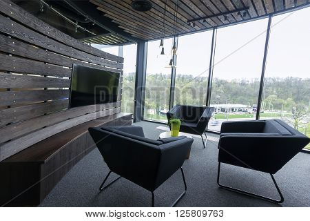 Modern meeting room or office closeup focusing surface of the table with chairs and covered with glass windows