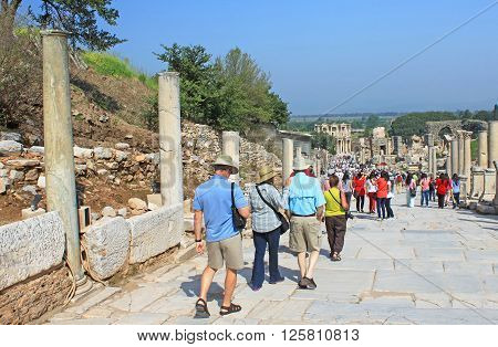 EPHESUS, TURKEY - APRIL 30, 2012: Tourists in Ephesus, Turkey. Ephesus was an ancient Greek city on the coast of Ionia three kilometres southwest of present-day Selcuk in Izmir Province, Turkey