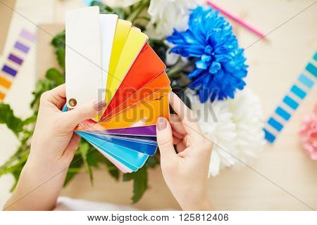 Female holding color swatch in hands