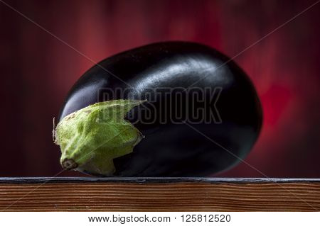 Ripe Aubergine on wooden table, horizontal view