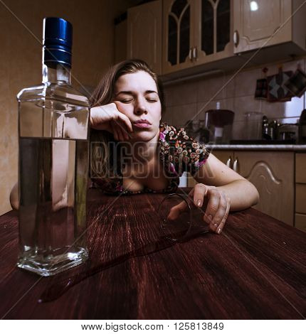 Drunk woman falling asleep with glass of alcoholic drink. Selective focus.