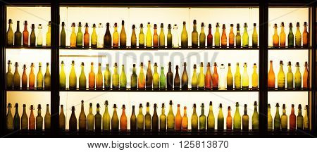 Cologne Germany - January 10 2014: Old beer bottles at a window of the Gaffel brewery who produce Kolsch a traditional beer from Cologne