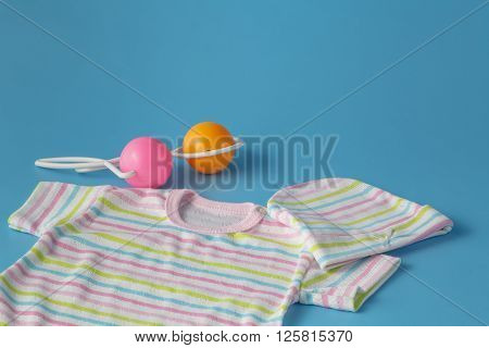 Baby Products on Blue plain Background with rattle
