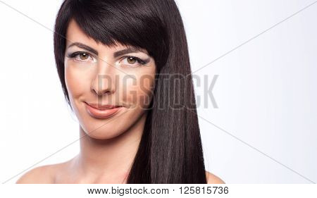 Beautiful portrait of a girl brunette closeup fashion style hair care hair smooth, sensual lips make-up and eyelash hair style idea, concept oils and shampoos for scalp care