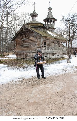 Vitoslavlitsy, Russia - March 12, Buffoon in the background of the church, March 12, 2016. Holiday Carnival in general Vitoslavlitsy near Novgorod.