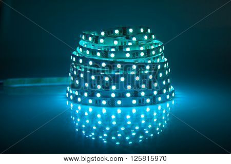 Blue glowing LED garland strip with reflection
