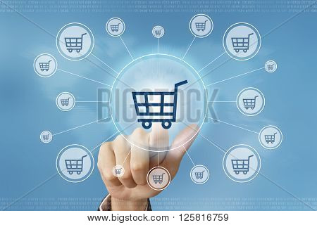 business hand pushing online shopping button with global networking concept