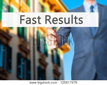 Fast Results - Businessman Hand Holding Sign