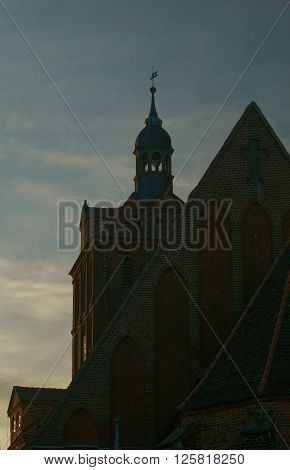 partial view of the sankt marien church from the city Dommitzsch in germany, with parts of the nave and the bell tower