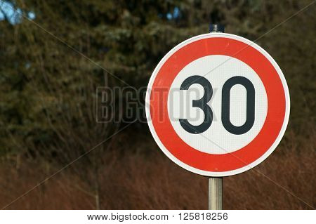 traffic sign with a speed limit 30 km/ h