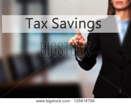 Tax Savings - Businesswoman Hand Pressing Button On Touch Screen Interface.