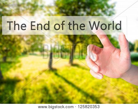 The End Of The World - Hand Pressing A Button On Blurred Background Concept On Visual Screen.