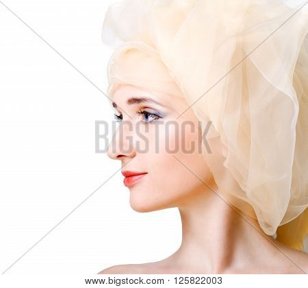 Portrait of attractive young woman with clear skin in scarf on head