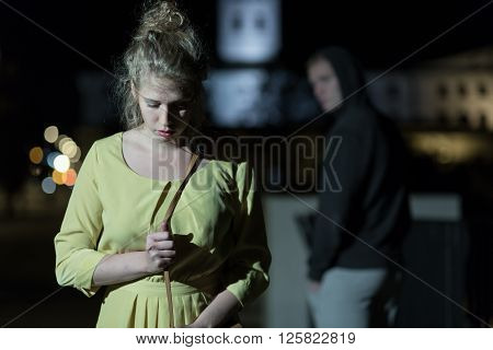 Criminal Observing Young Woman