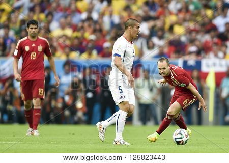 RIO DE JANEIRO BRAZIL - June 18 2014: Francisco SILVA of Chile and Andres INIESTA of Spain during the FIFA 2014 World Cup. Spain is facing Chile in the Group B at Maracana Stadium