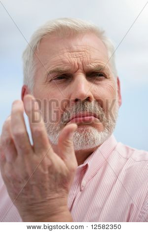 Portrait of  a senior man skeptical