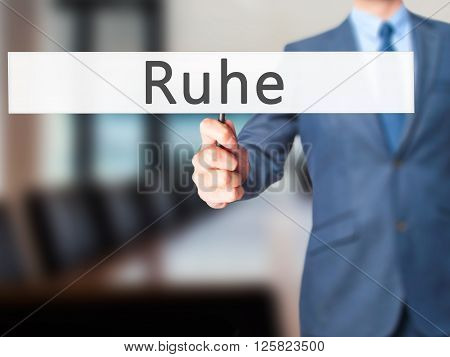 Ruhe (quiet In German) - Businessman Hand Holding Sign