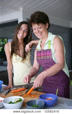 Senior woman and young woman cooking