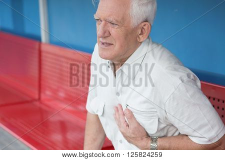 Picture of senior man having heart attack