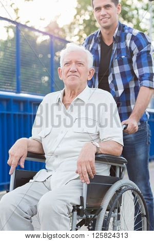 Smiling Man On Wheelchair