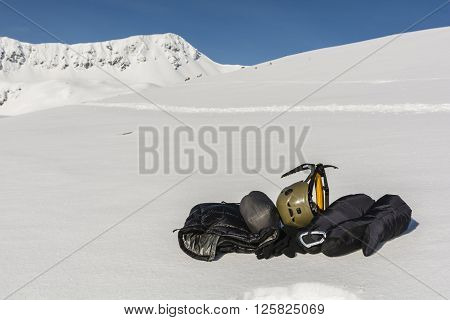 Helmet, Ice Axe, Gloves And Clothing Down.